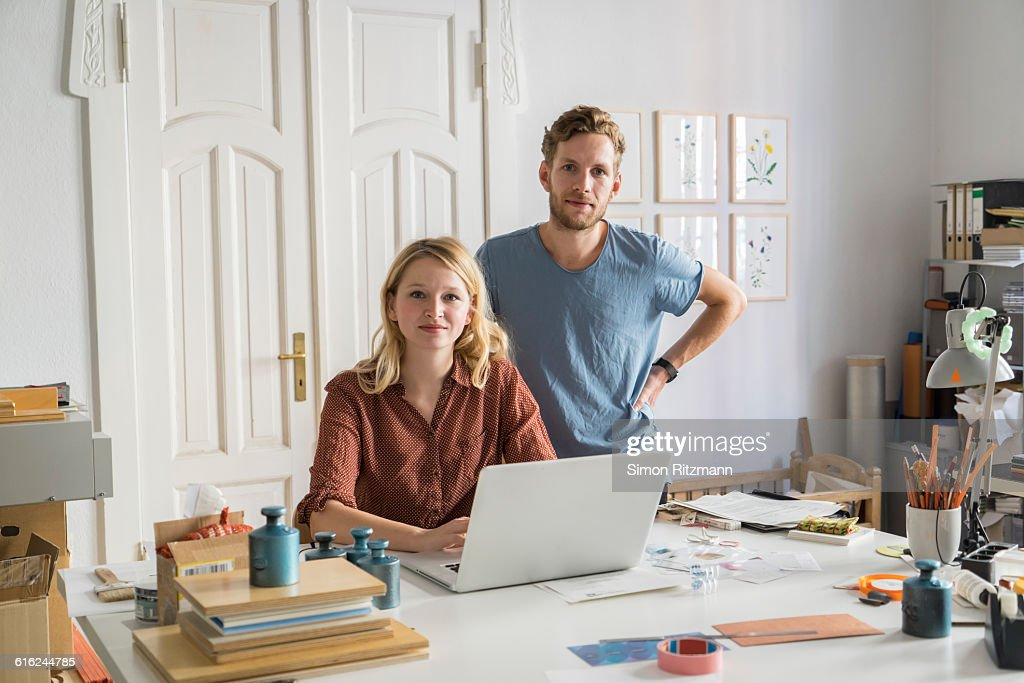 Portrait of businessman and businesswoman at work : Stock Photo