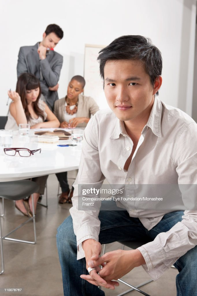 Portrait of businessman at boardroom table. : Stock Photo