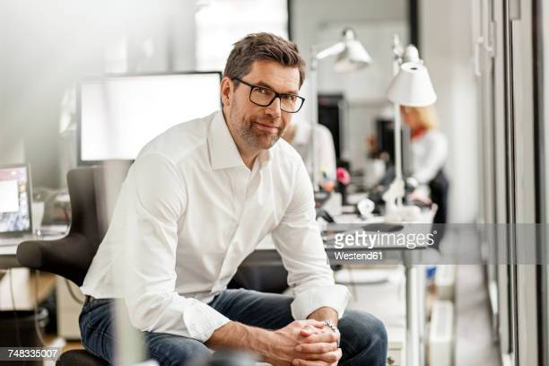 Portrait of businessman at desk in office