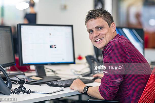 Portrait of businessman at his desk in the office
