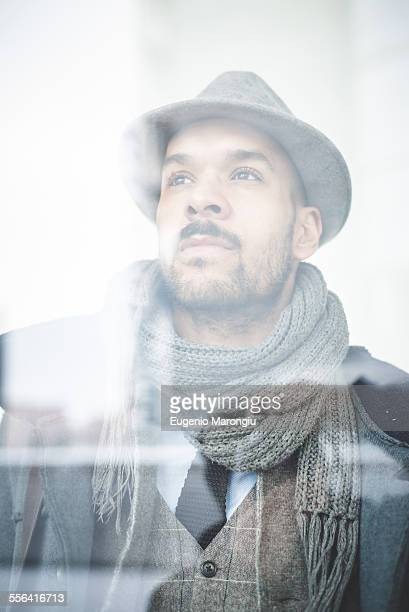 Portrait of businessman behind window