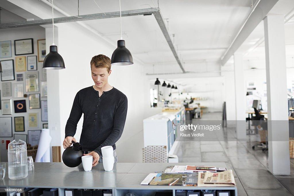 Portrait of businessman having a coffee break
