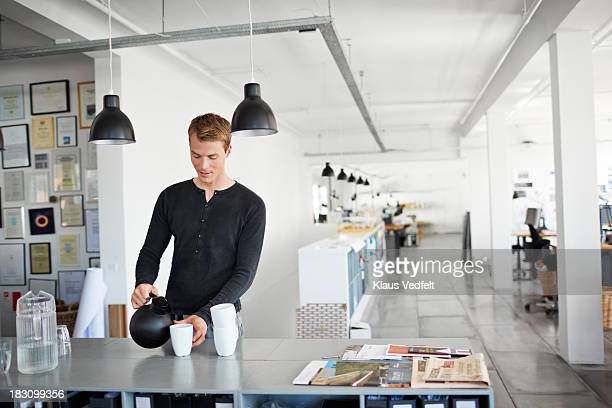 Portrait of businessman having a coffee break