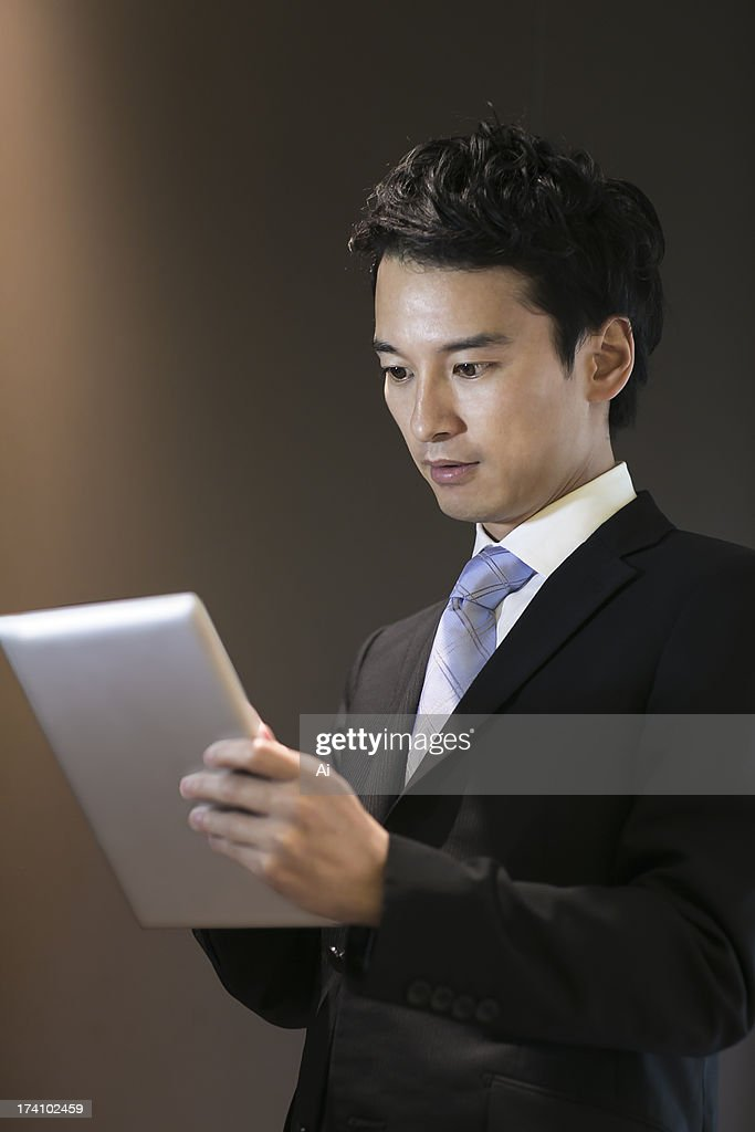 Portrait of businessman holding digital tablet : Stock Photo