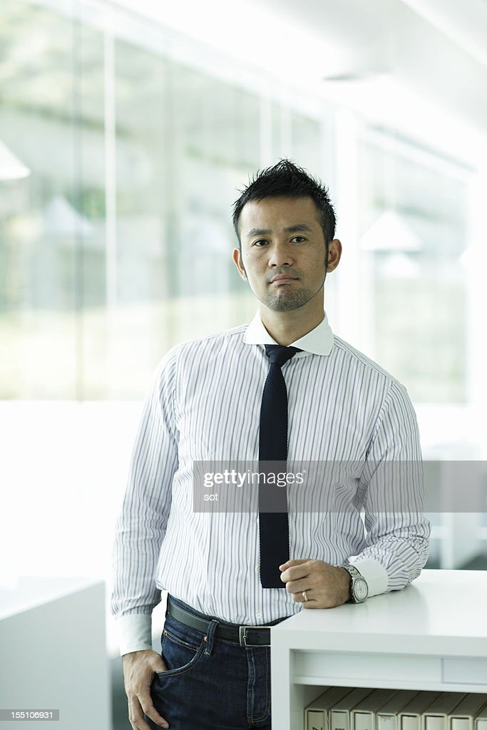 Portrait of businessman in office hallway