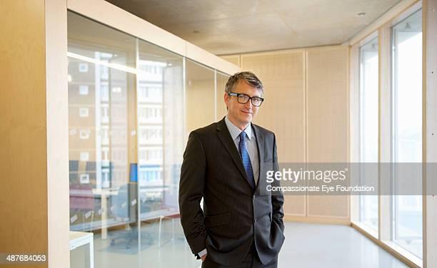 Portrait of businessman in office hallway