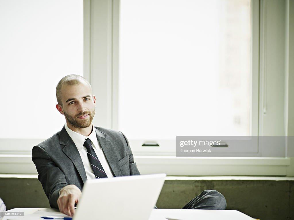 Portrait of businessman in office laptop on table : Stock Photo
