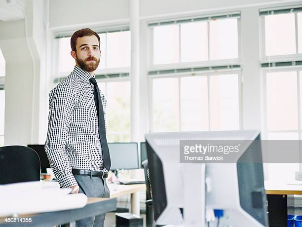 Portrait of businessman in office workstation