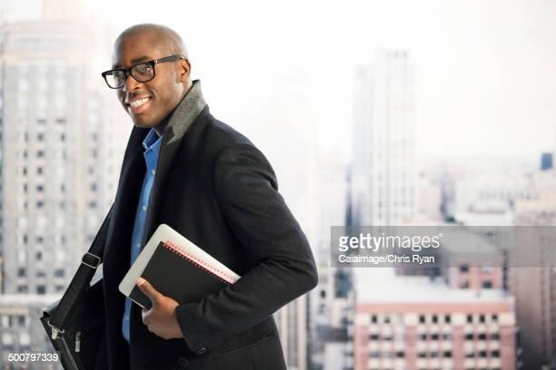 Portrait of businessman in urban window