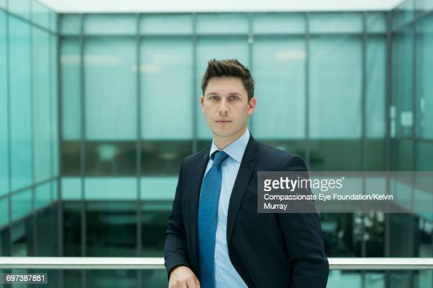 Portrait of businessman on atrium balcony