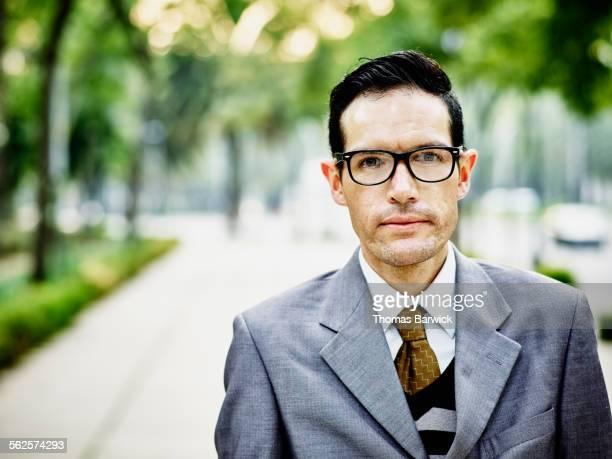 Portrait of businessman on sidewalk of city street