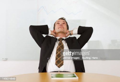 Portrait of businessman relaxing at desk