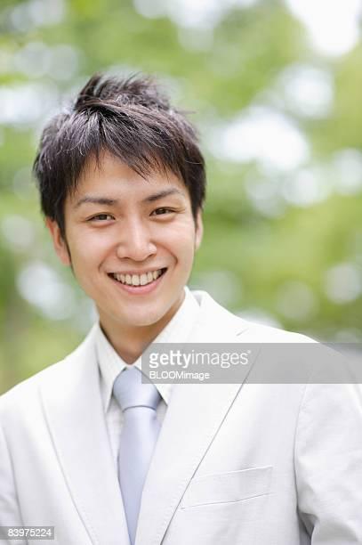 Portrait of businessman smiling, close up