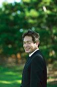Portrait of businessman smiling outdoors