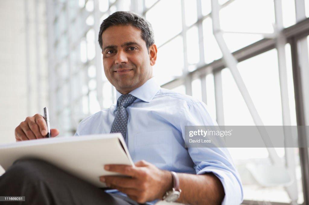 Portrait of businessman, smiling
