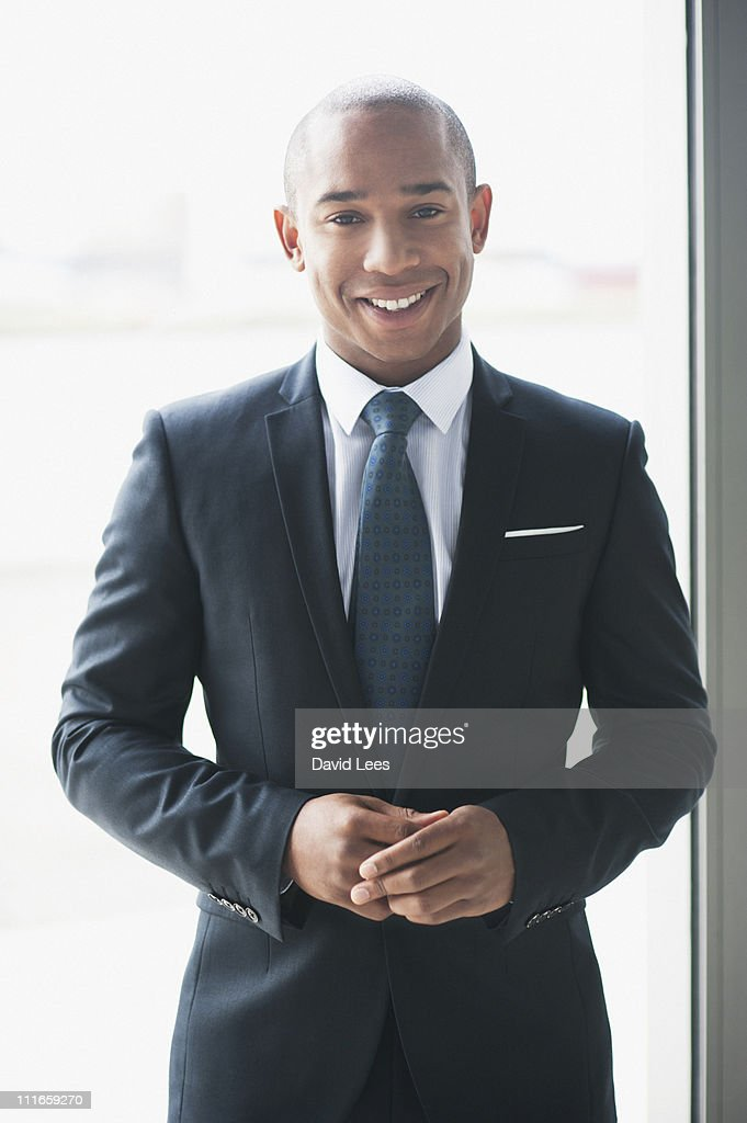 Portrait of businessman, smiling : Foto stock