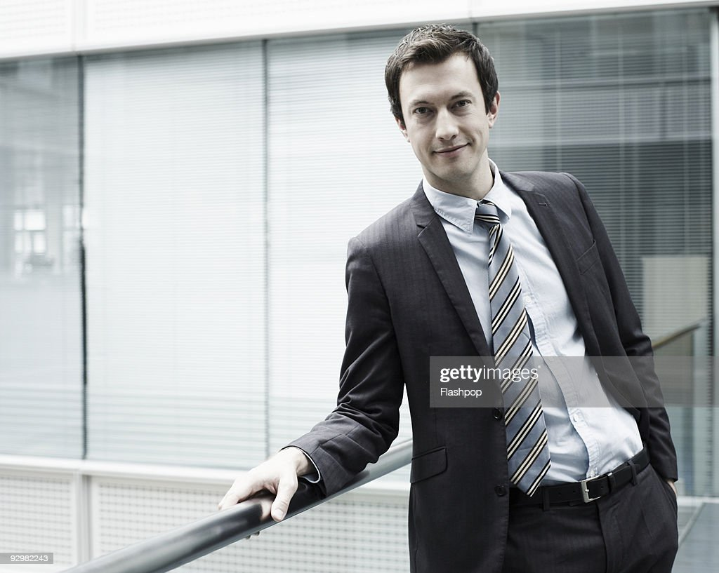 Portrait of businessman smiling to camera : Stock Photo