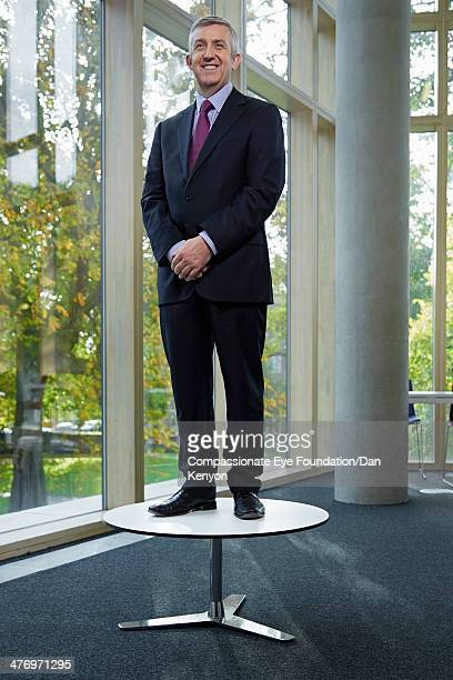 Portrait of businessman standing on table