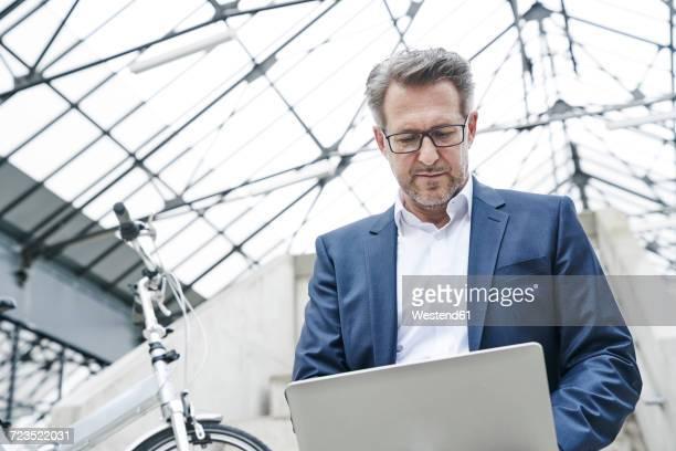Portrait of businessman using laptop