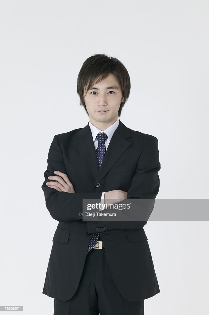 Portrait of businessman with arms crossed : Stock Photo