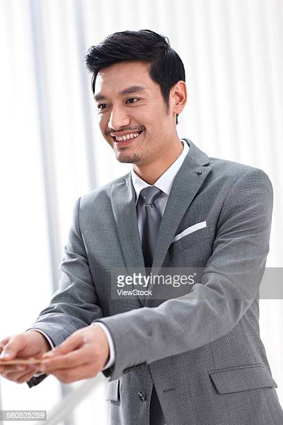 Portrait of businessman with credit card