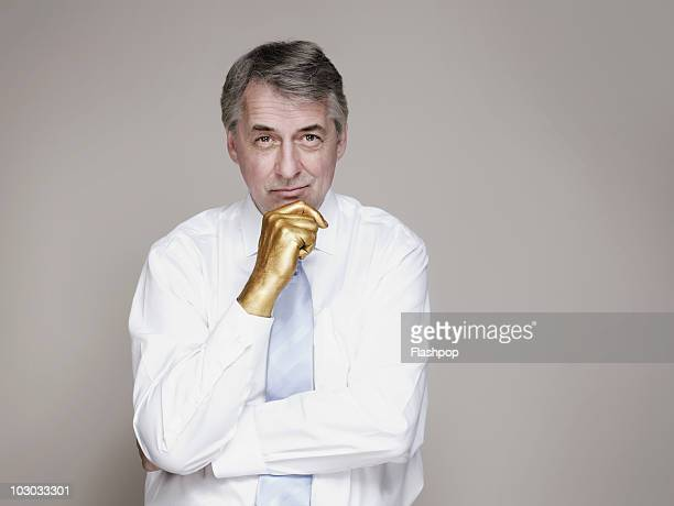 Portrait of businessman with golden hand