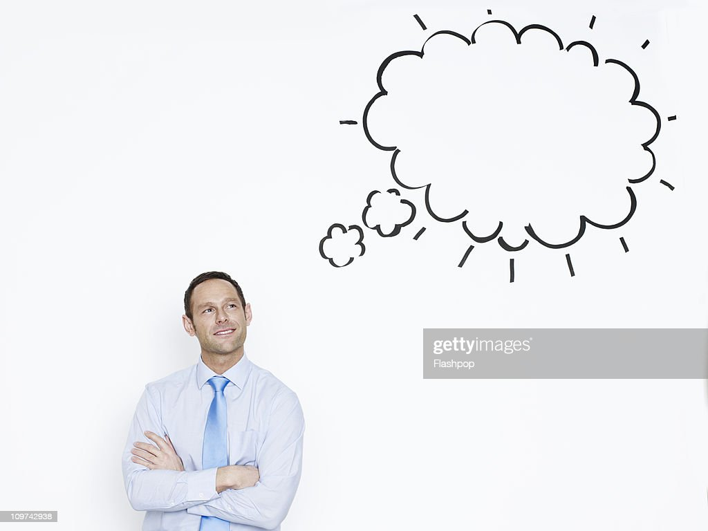 Portrait of businessman with thought bubble : Stock Photo