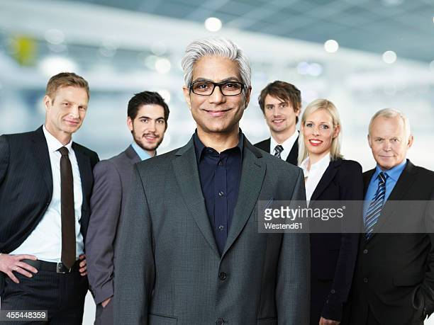 Portrait of businessmen and woman, smiling