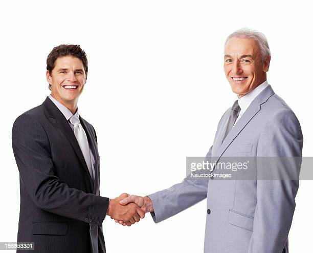 Portrait Of Businessmen Shaking Hands - Isolated