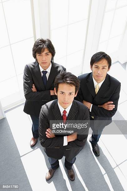 Portrait of businessmen with arms folded, high angle view
