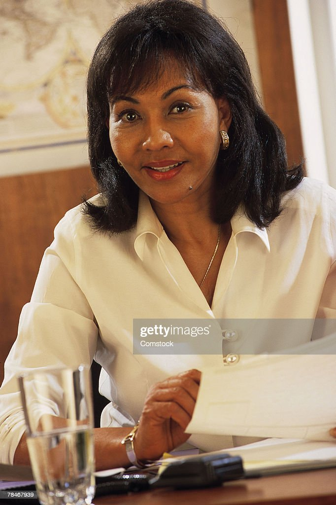 Portrait of businesswoman at her desk : Stock Photo