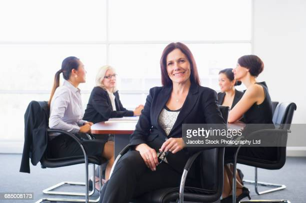 Portrait of businesswoman at meeting in conference room
