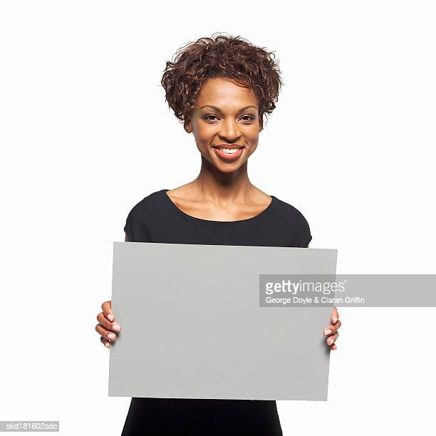 Portrait of businesswoman holding blank card