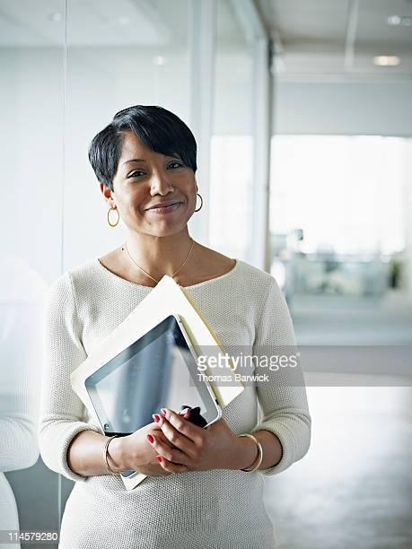 Portrait of businesswoman holding digital tablet