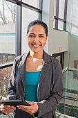 Portrait of businesswoman holding tablet