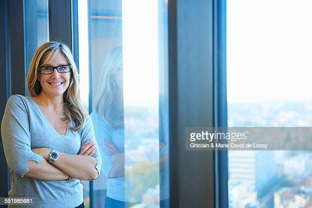 Portrait of businesswoman in skyscraper office, Brussels, Belgium