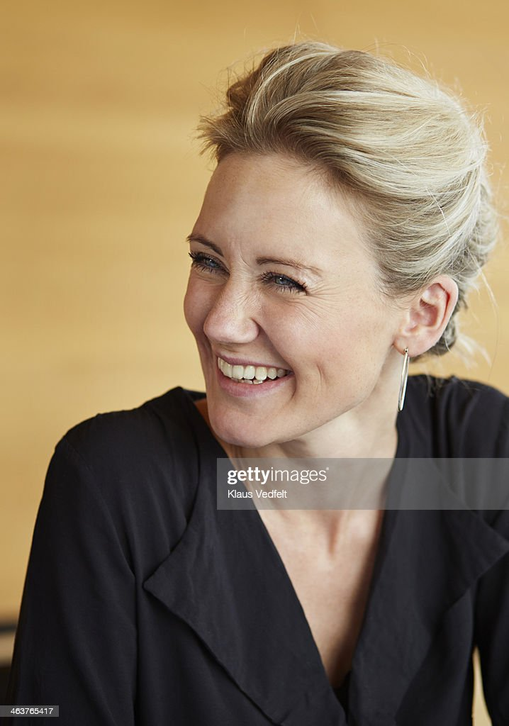 Portrait of businesswoman laughing : Stock Photo
