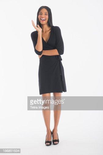 Portrait of businesswoman laughing, studio shot