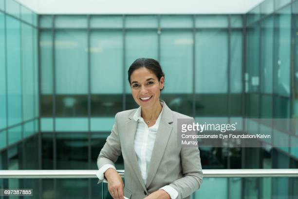 Portrait of businesswoman on atrium balcony
