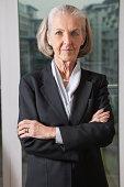 Portrait of confident senior businesswoman with arms crossed