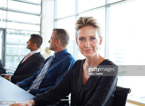 Portrait of businesswoman sitting in a meeting