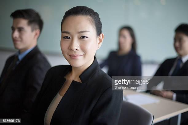 Portrait of businesswoman sitting in classroom
