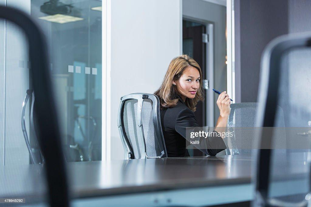 Portrait of businesswoman sitting in office boardroom