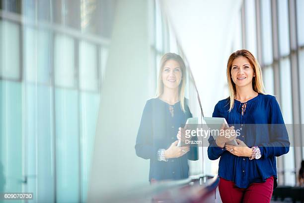 Portrait of businesswoman, smiling and expressing positivity