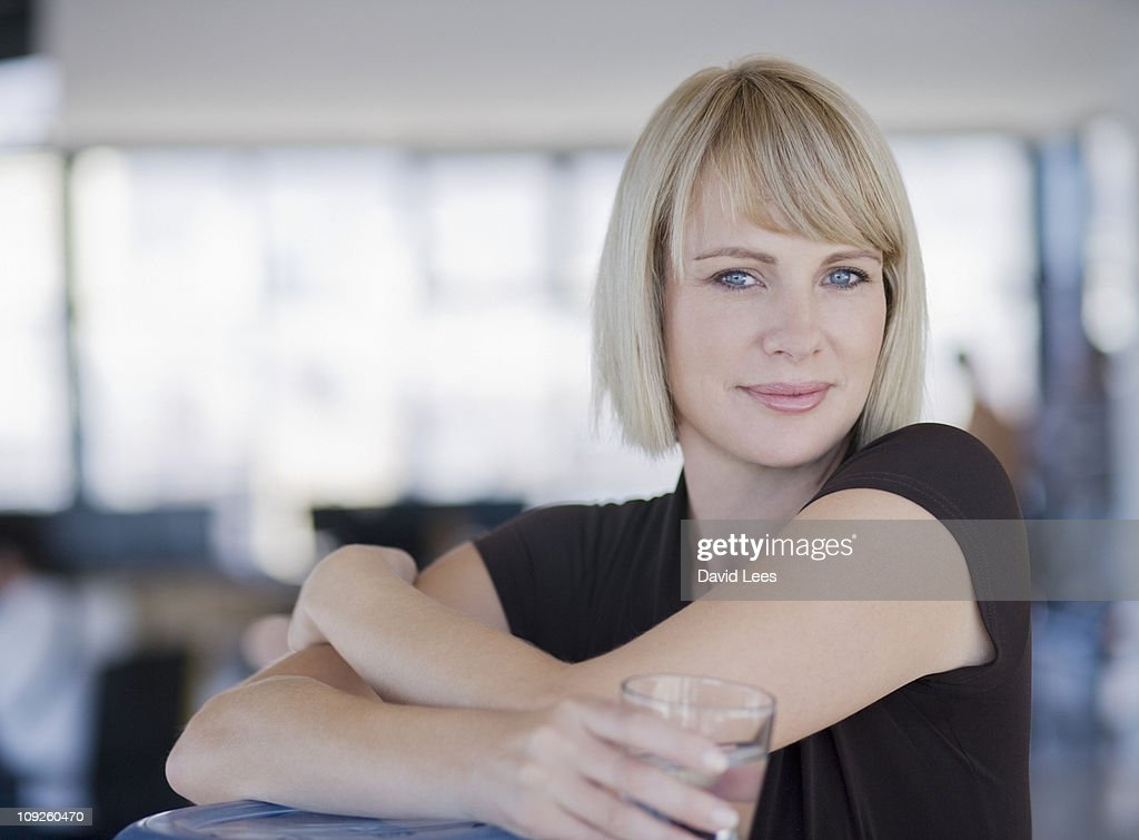 Portrait of businesswoman, smiling : Stock Photo