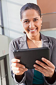 Portrait of businesswoman smiling with a tablet