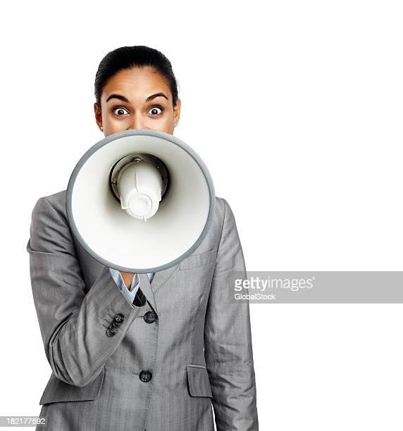 Portrait of businesswoman speaking in a megaphone