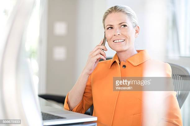 Portrait of businesswoman telephoning in an office