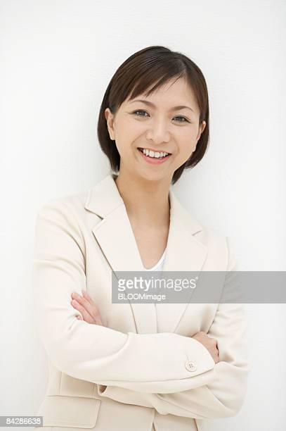 Portrait of businesswoman with arms folded, close-up