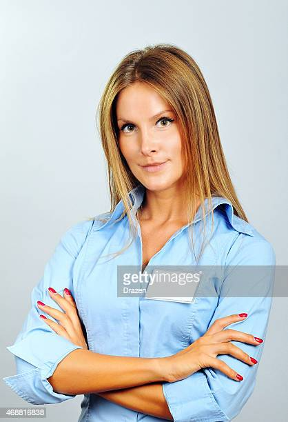Portrait of businesswoman with name tag